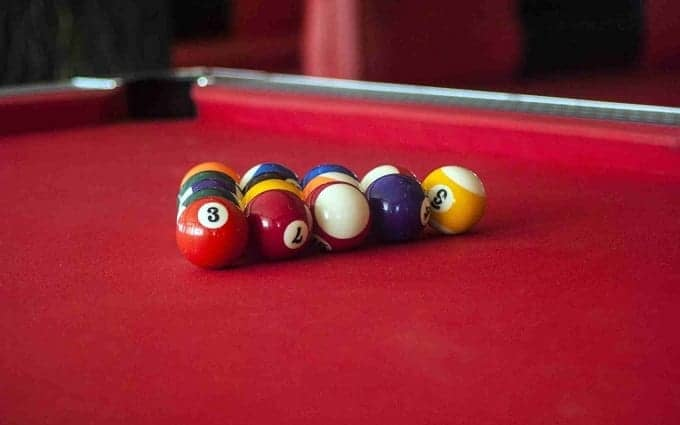 Balls On Pool Table With Red Felt